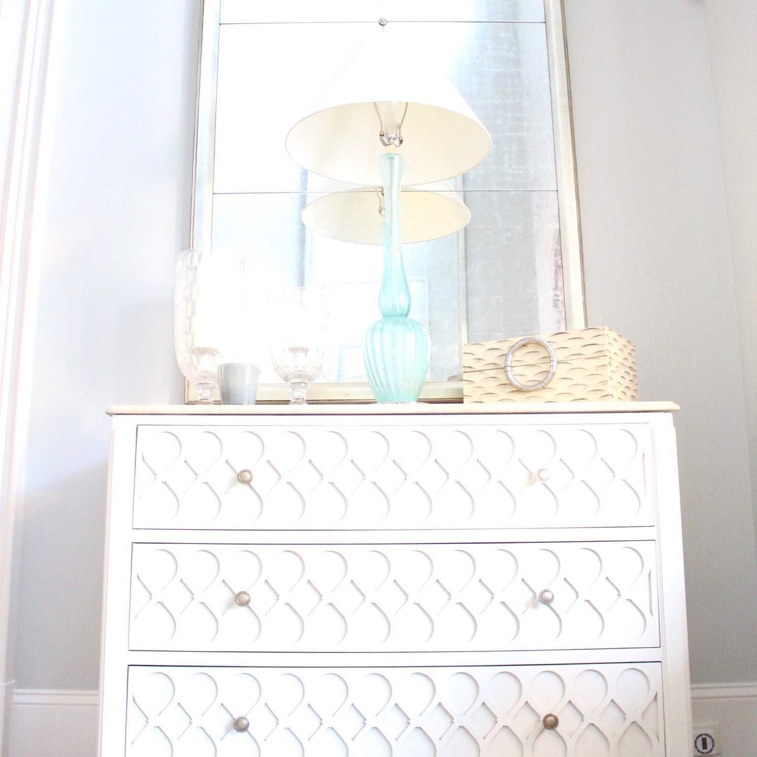 Bright Foyer Decor details. Hall chest with turquoise lamps.
