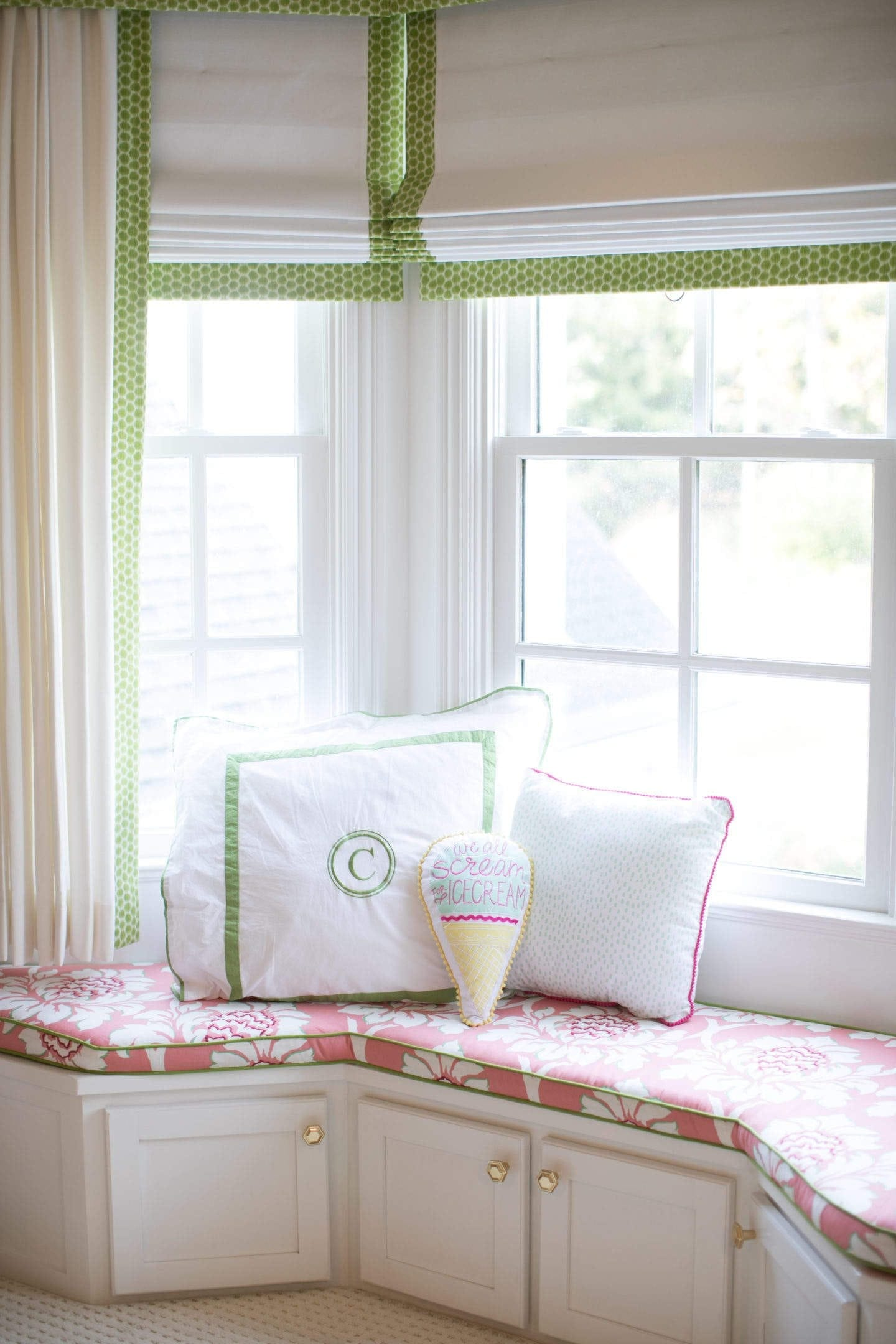 window seat with coral and white and green and white drapery in a 9 year old girl bedroom makeover