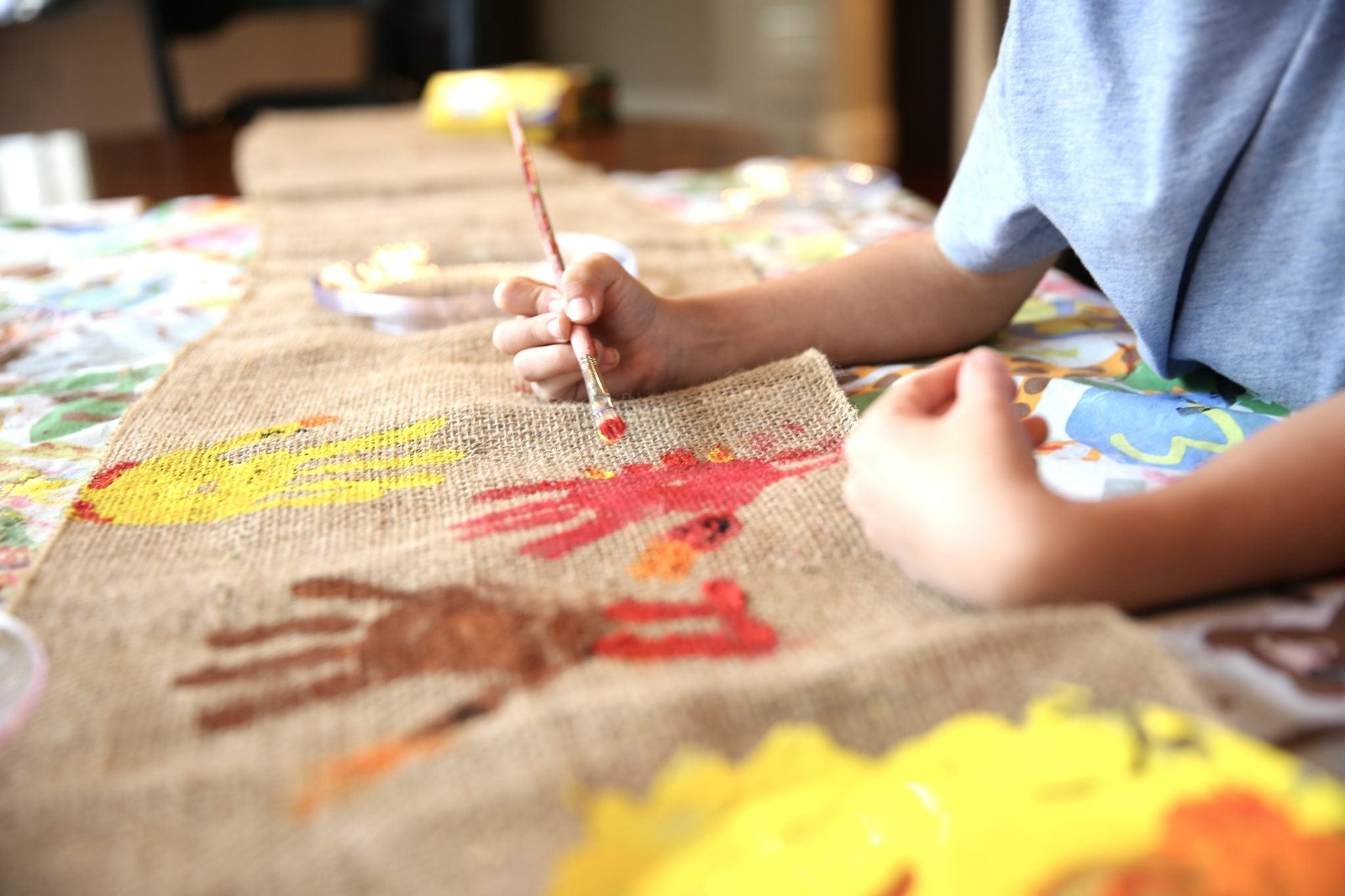 Thanksgiving table runner for kids. A cute Thanksgiving craft that is easy and inexpensive!