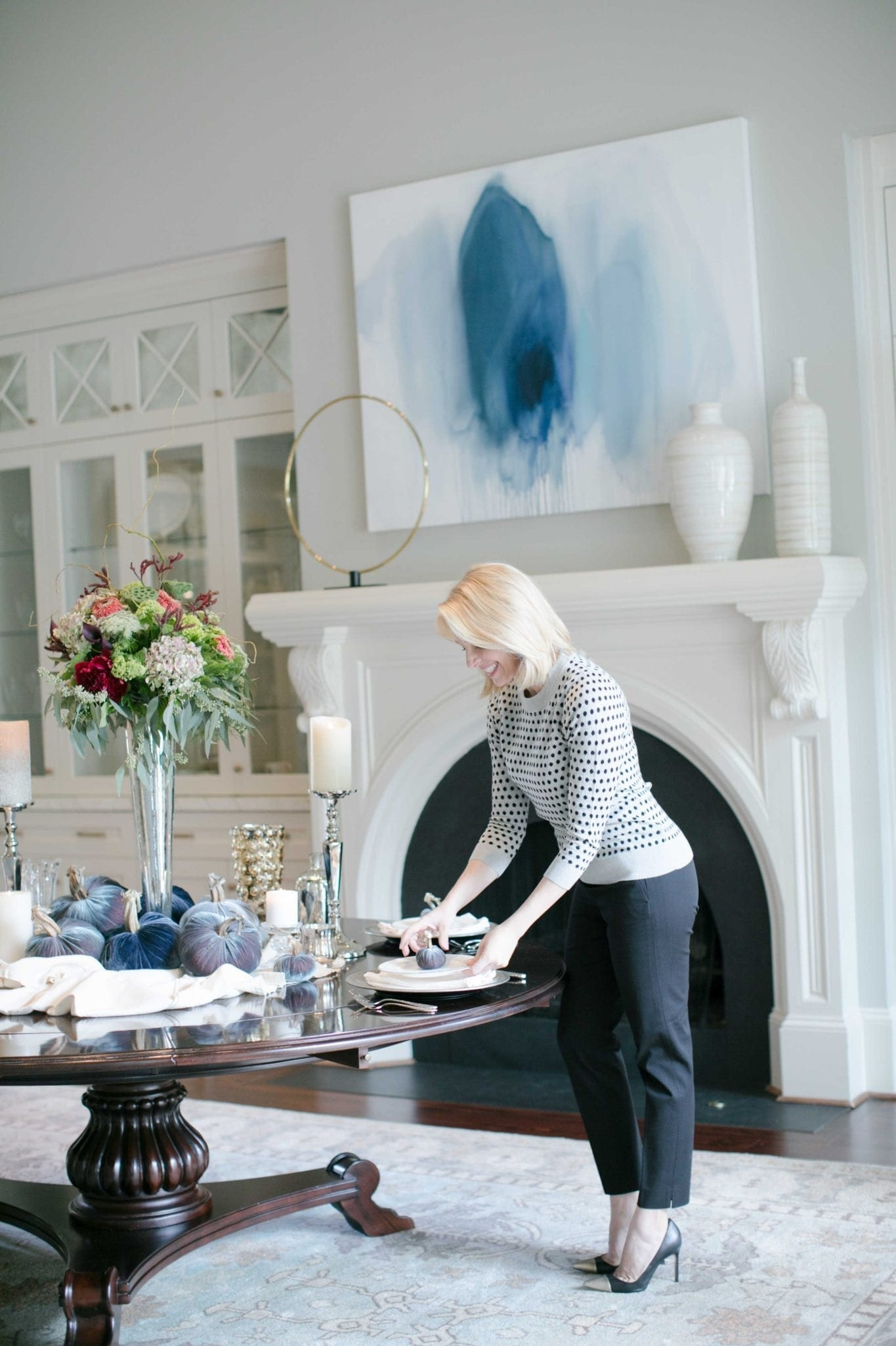 Formal dining room decor. Round table with oversized white mantel. Lifestyle blogger Kelly Page for bluegraygal.