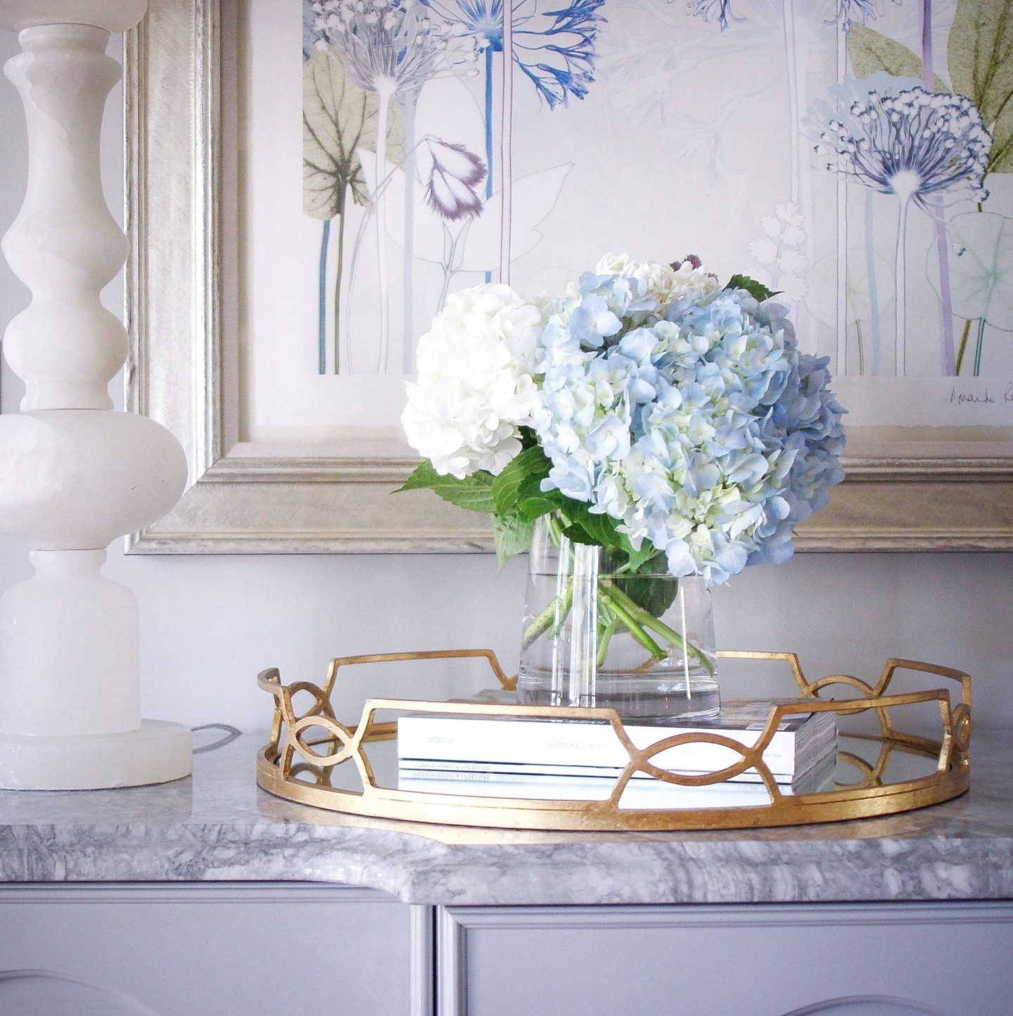 Simple hydrangea arrangement for buffet tables Gold tray and marble white lamps to add light.