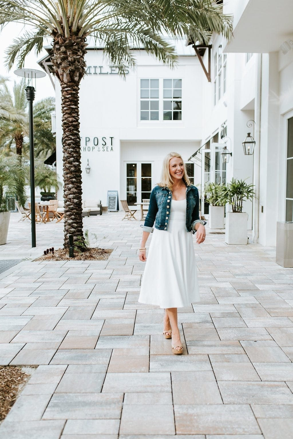 White summer dress and crop jean jacket outfit. White summer dress for women with nude patent leather wedges and a cute crop jacket. Perfect summer outfit for women!