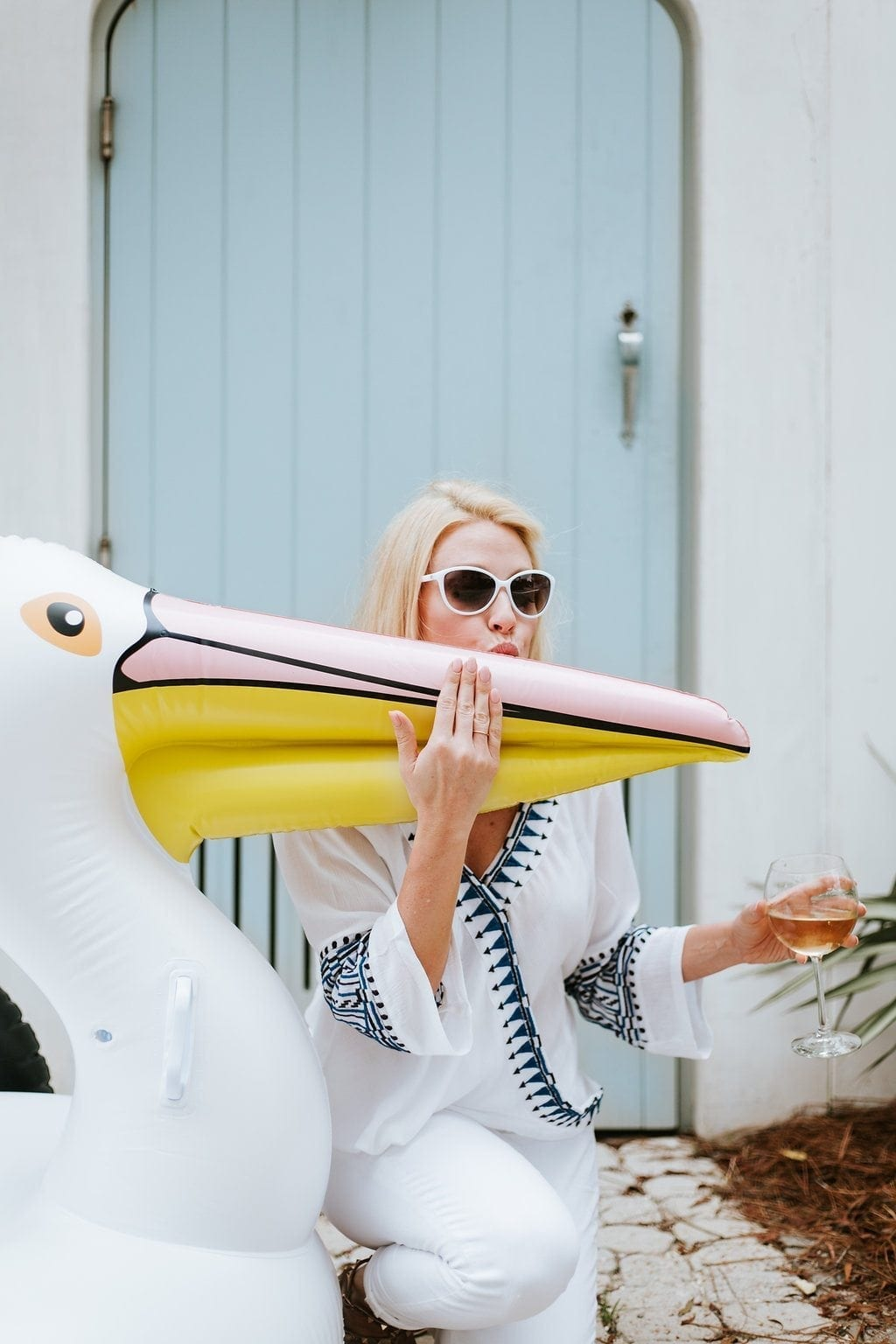 Pelican pool float and white sunglasses.