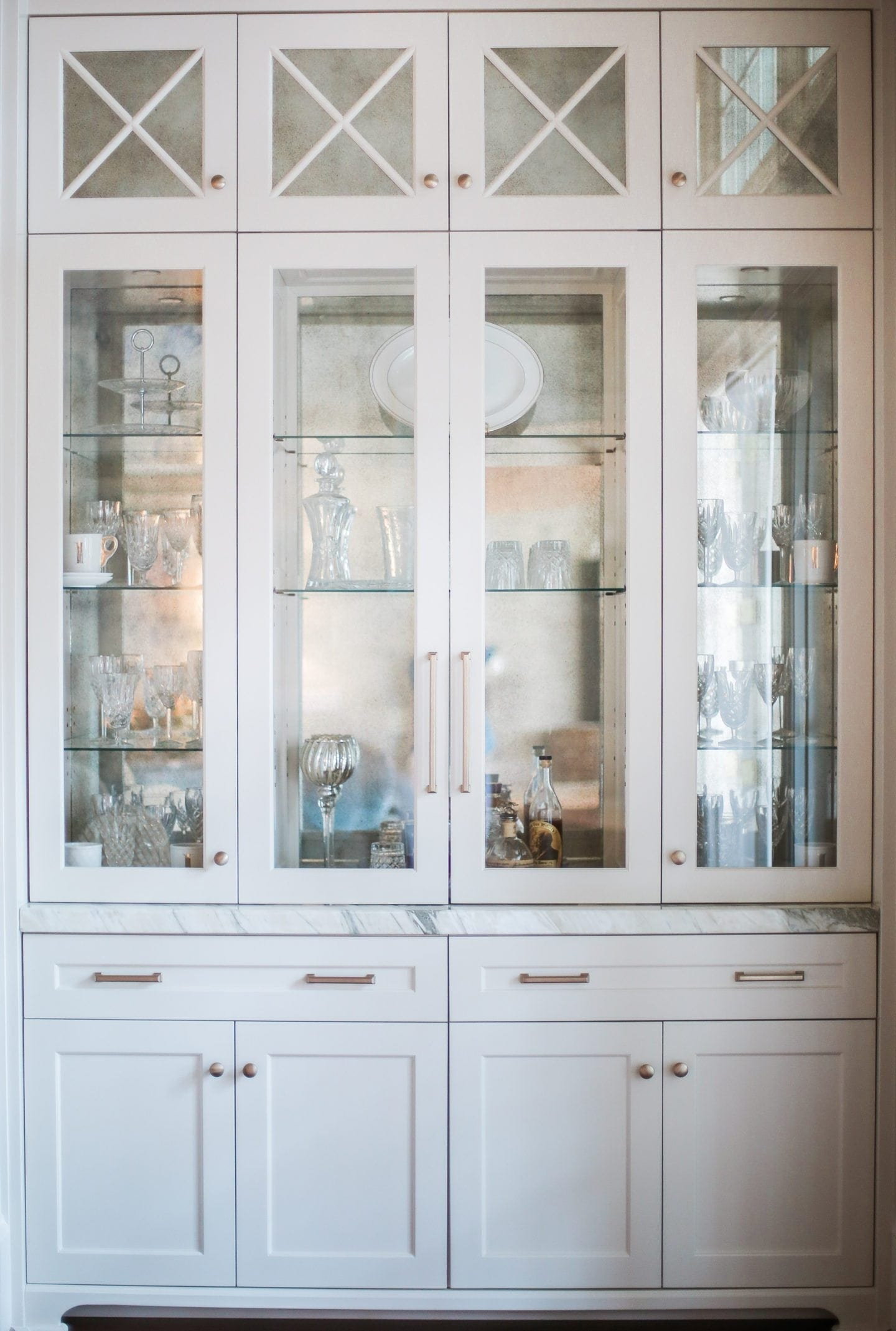 Beyond beautiful dining room storage in white gold for Built in dining room cabinet designs