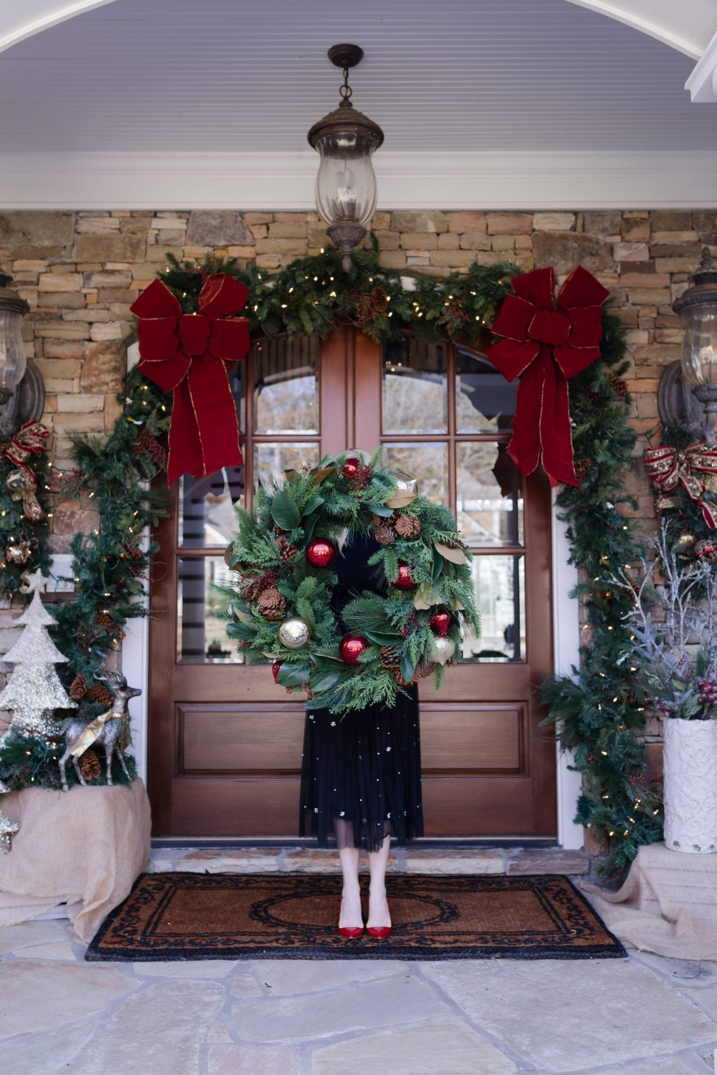 Frontgate holiday wreaths. Outdoor bows for garland and front door decor.