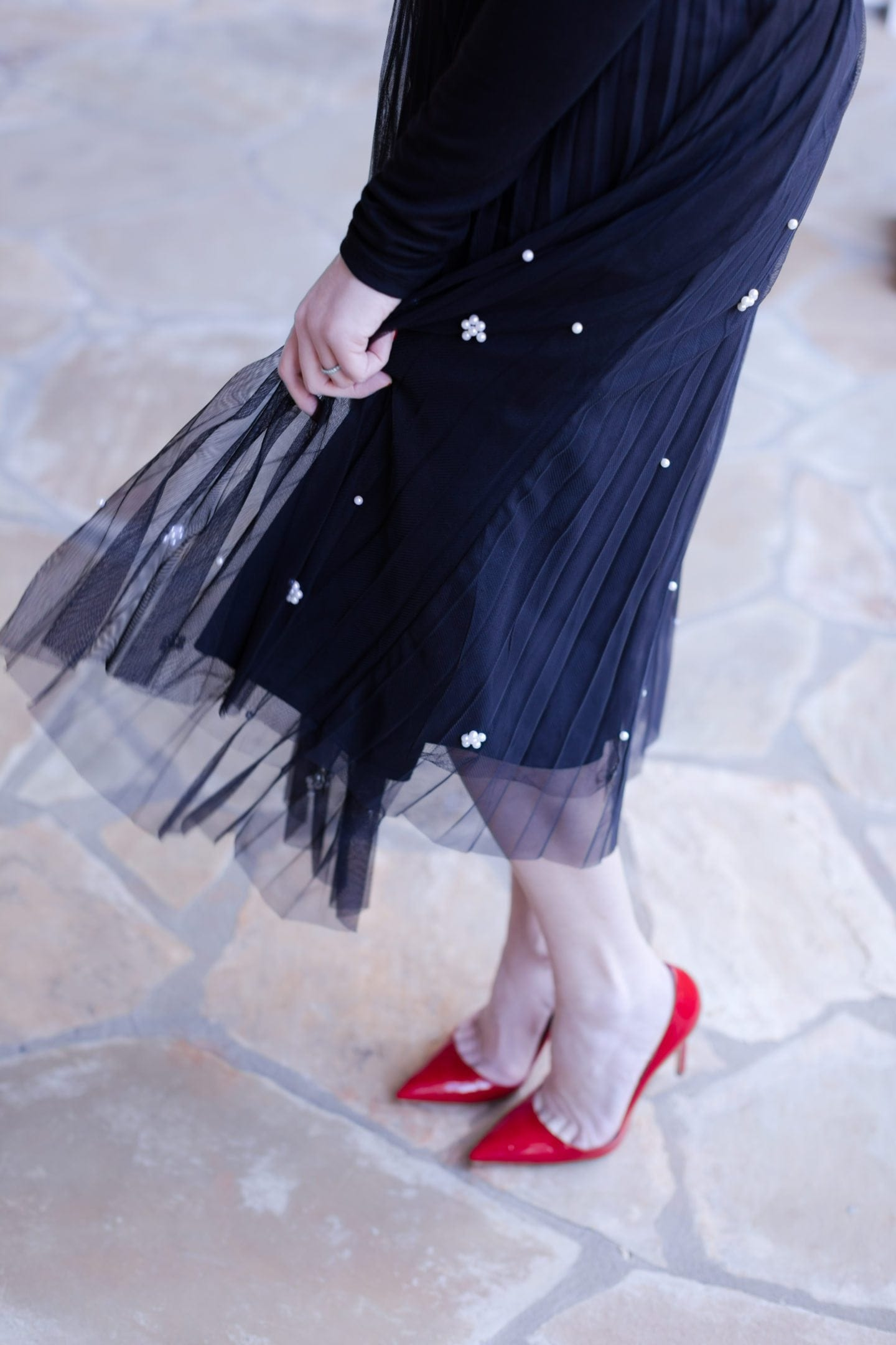 Thanksgiving wear. Red patent leather shoes with black midi length skirt with embellished pearl detail.