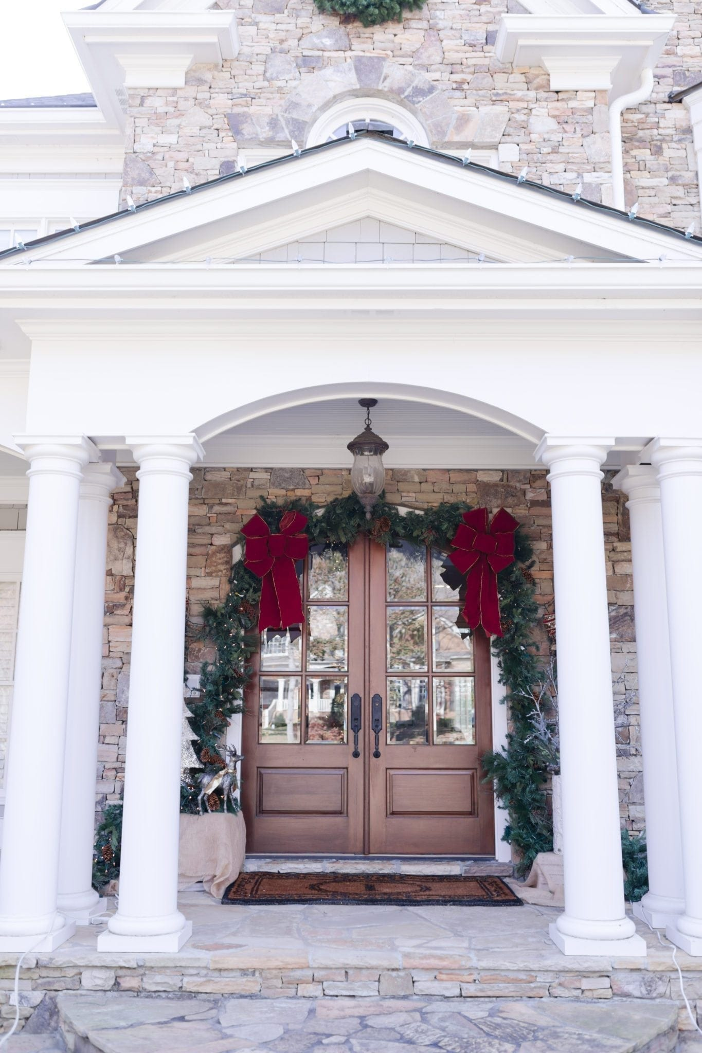 Christmas Decorations for the front door. Garland hung around door frame.