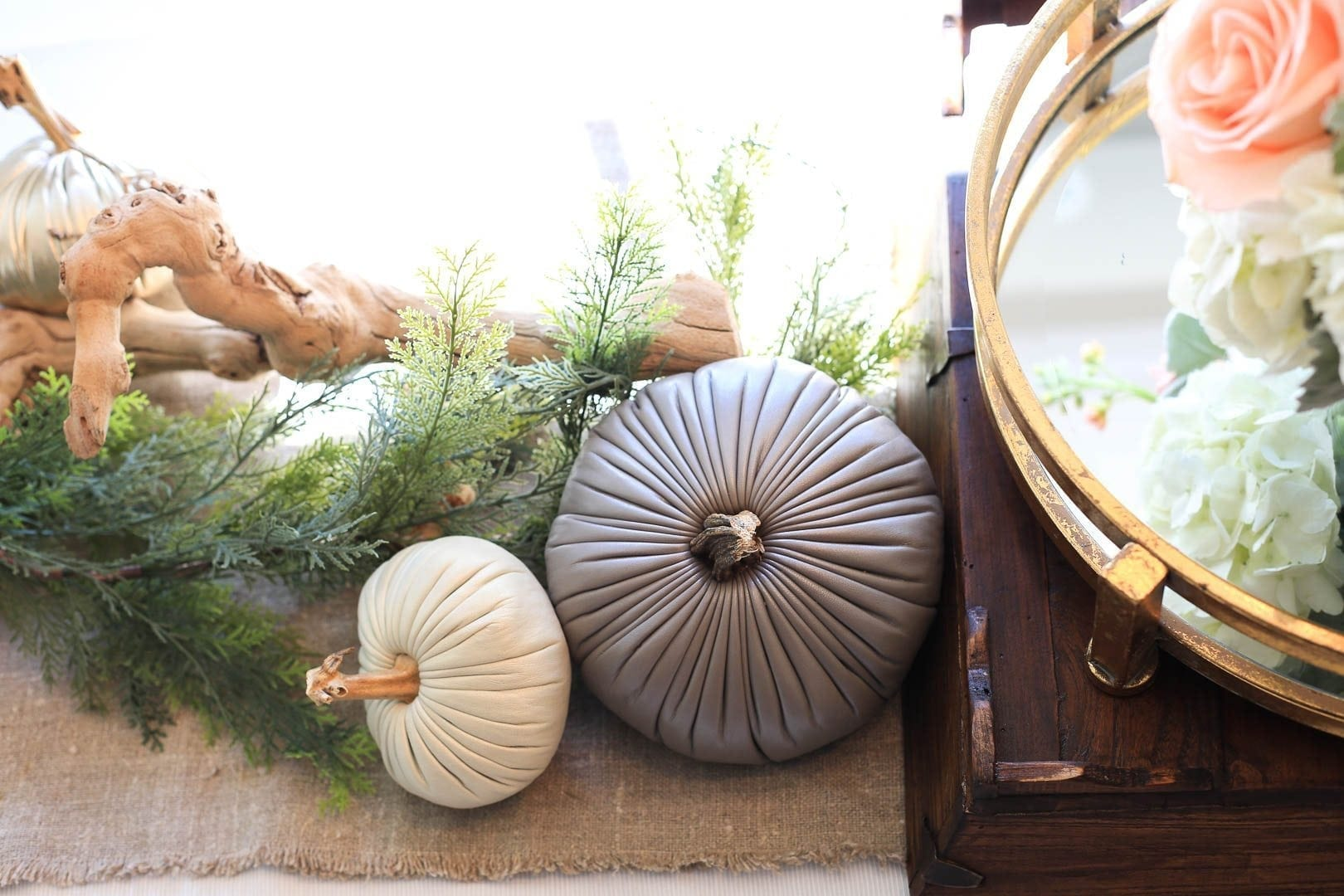 Decorative Pumpkins with real stems mixed with faux greenery.