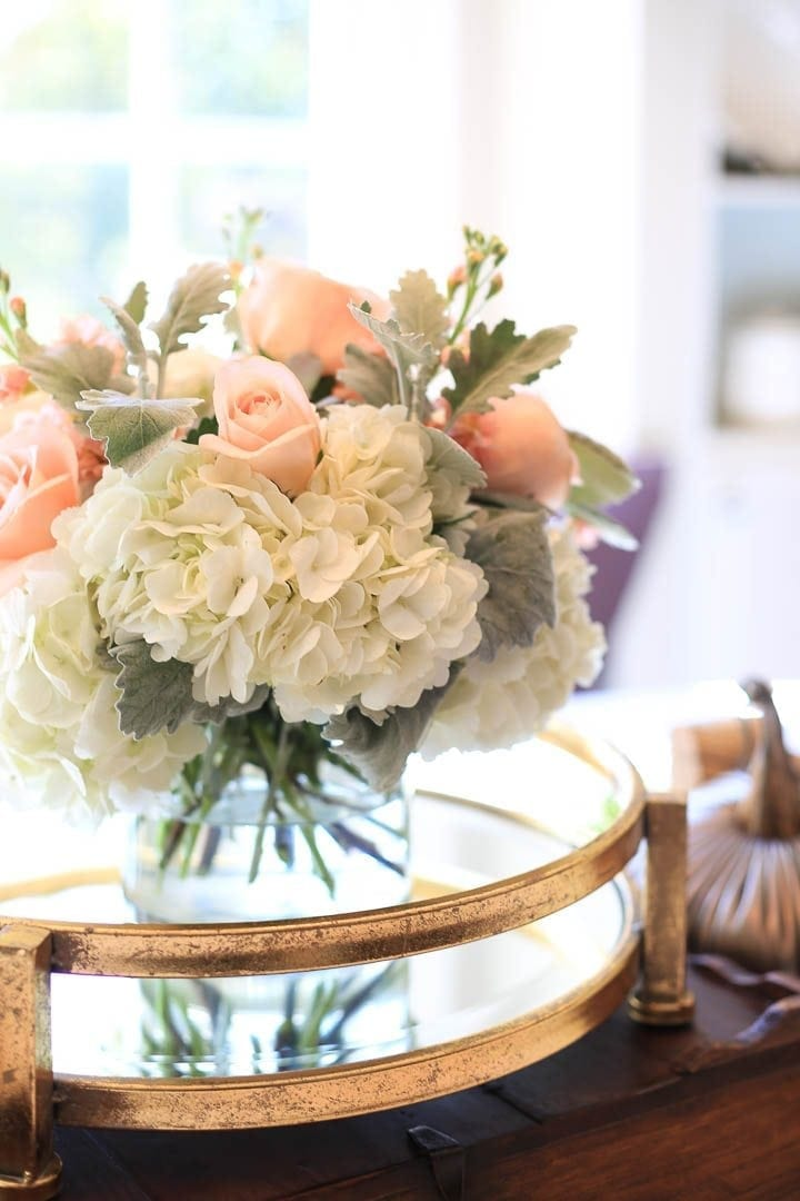 Find a florist nearby whose qualified. Peach flowers with white hydrangea and dusty miller.