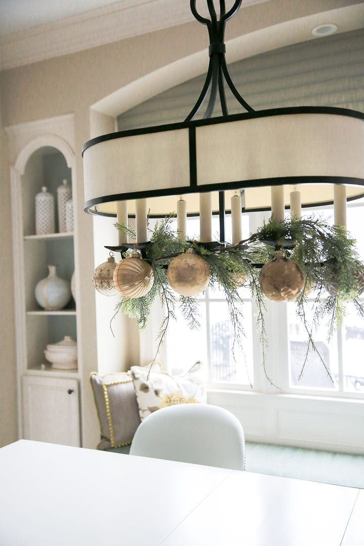 How to hang ornaments from a light fixture.