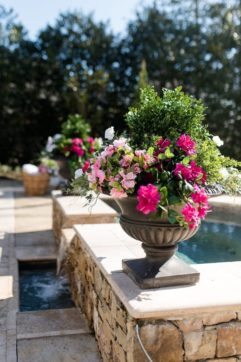 Pool flowers by the spa for gorgeous pink and green color.