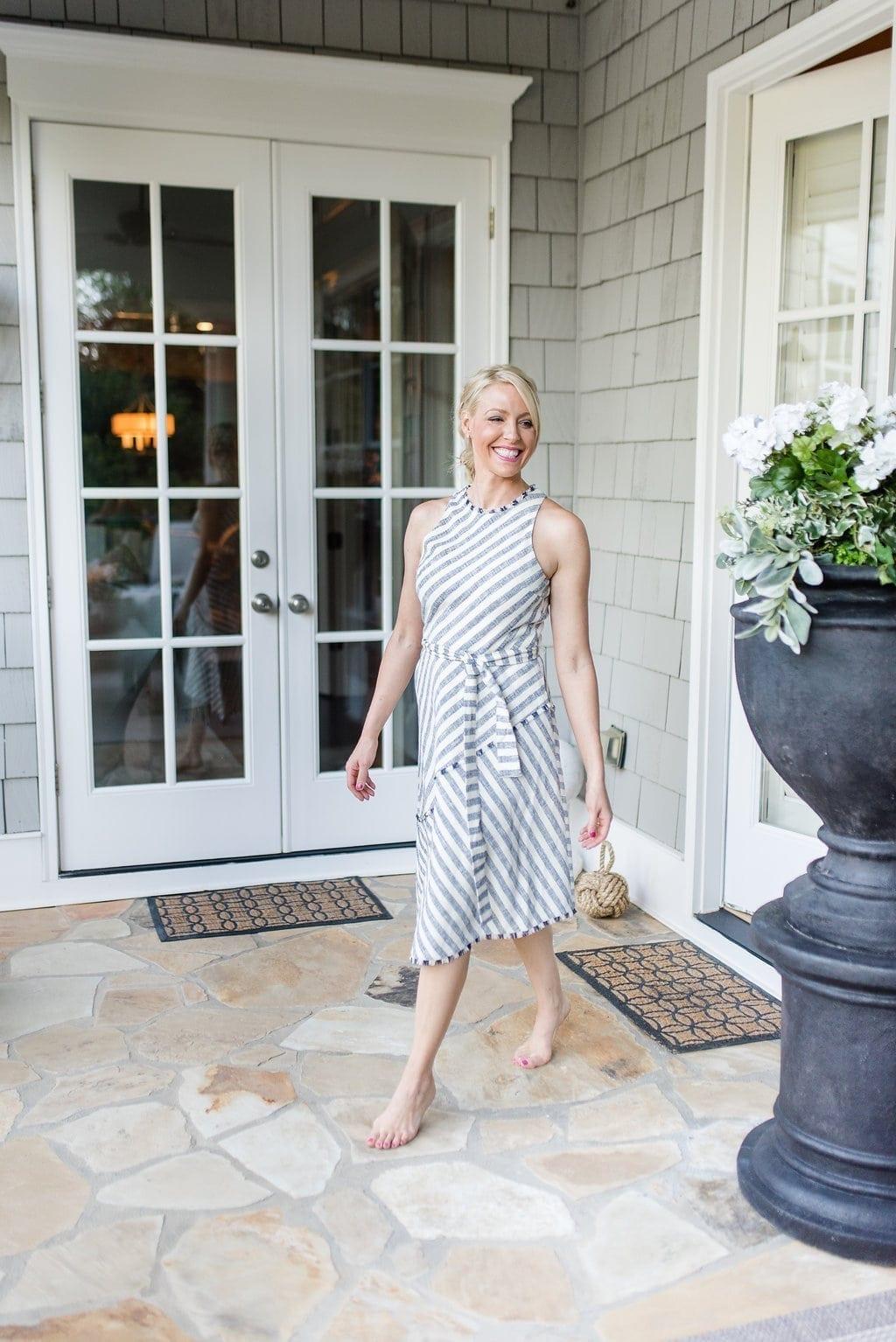 Stripe asymmetrical dress with high neckline and waist tie.