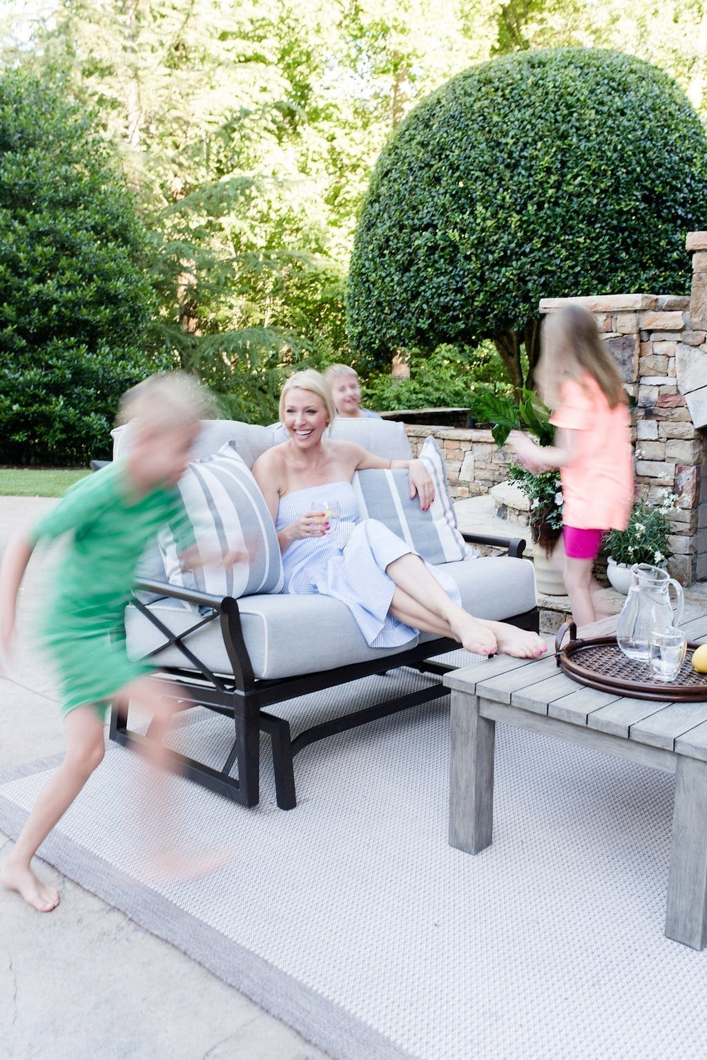 Atlanta Homes and Lifestyle. Lifestyle blogger, bluegraygal, and her children in their Atlanta area home sitting on Woodard Outdoor Furniture.