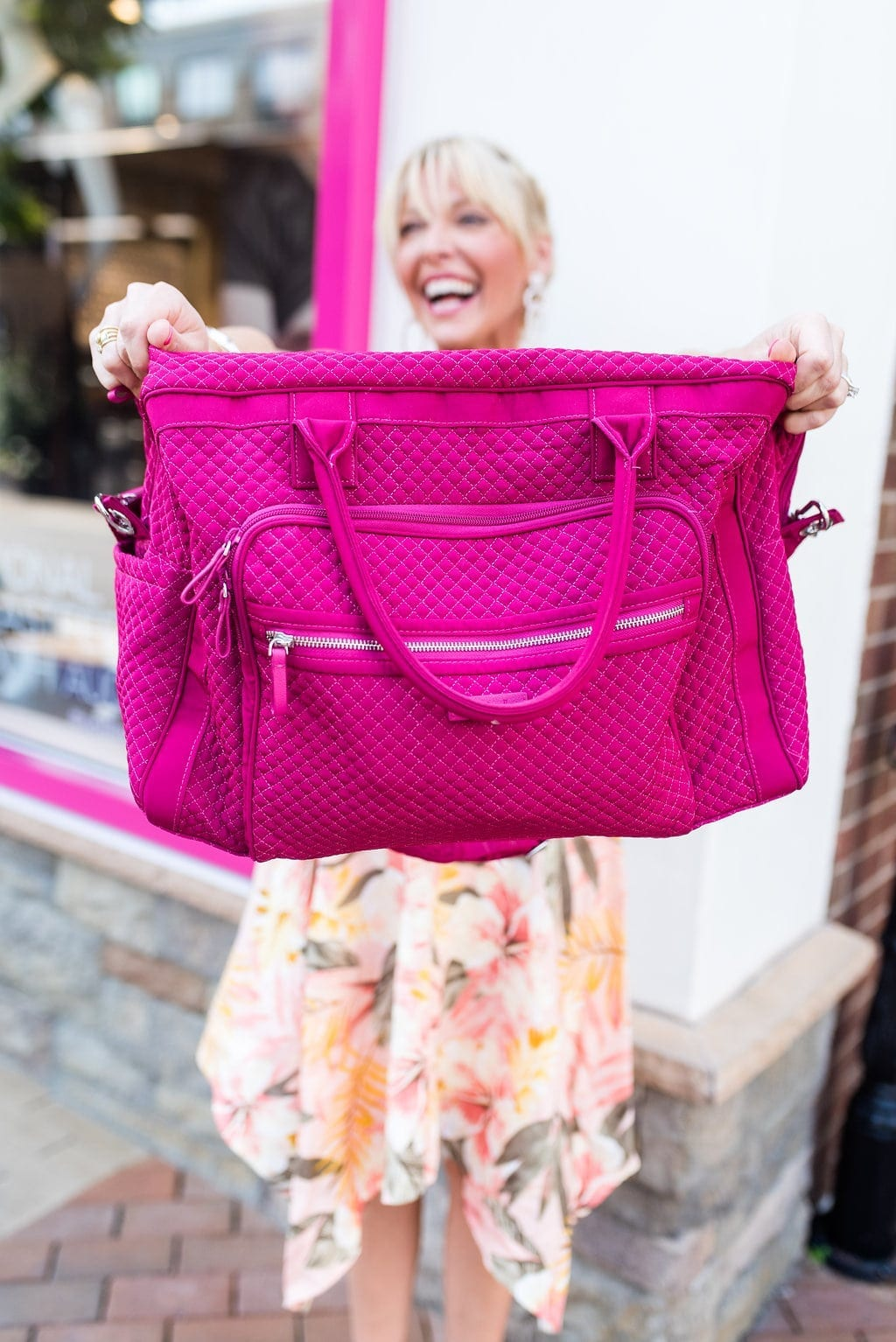 Vera Bradley Weekender Bag in pink with floral midi dress.