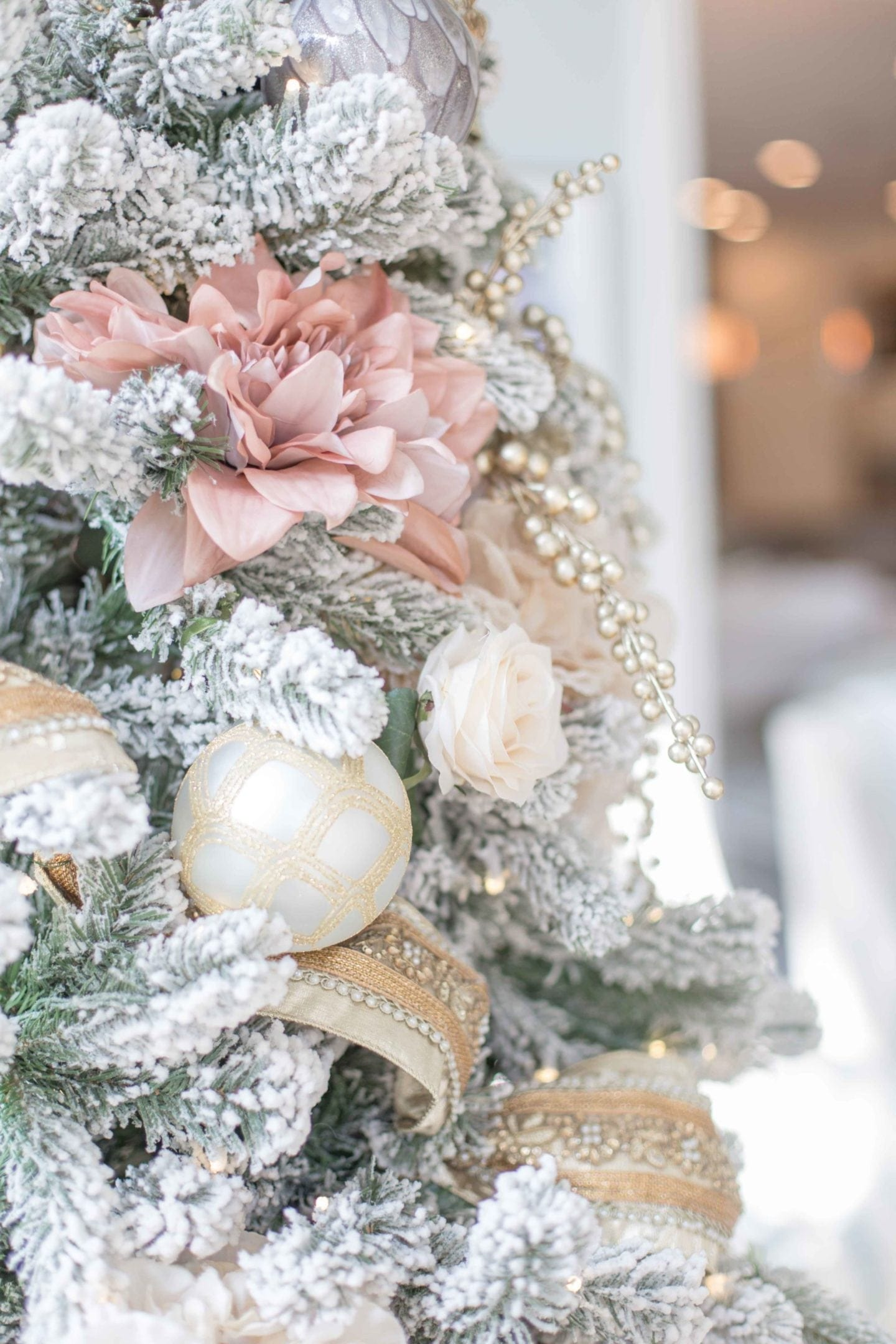 Fake hydrangeas on a Christmas Tree. A beautiful tree decorated in shades of blush pink with Frontgate ornaments and flowers from AFloral.com