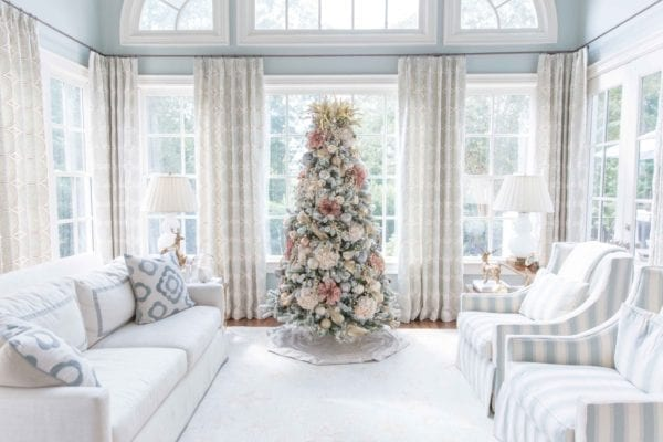 Pink Flocked Christmas Tree. Decorate your Christmas tree with faux flowers, ornate ribbon and stunning Frontgate ornaments. A tree of mauve and ivory is a unique and soft way to decorate your flocked Christmas Tree! Lots of Christmas Tree ideas coming this year!