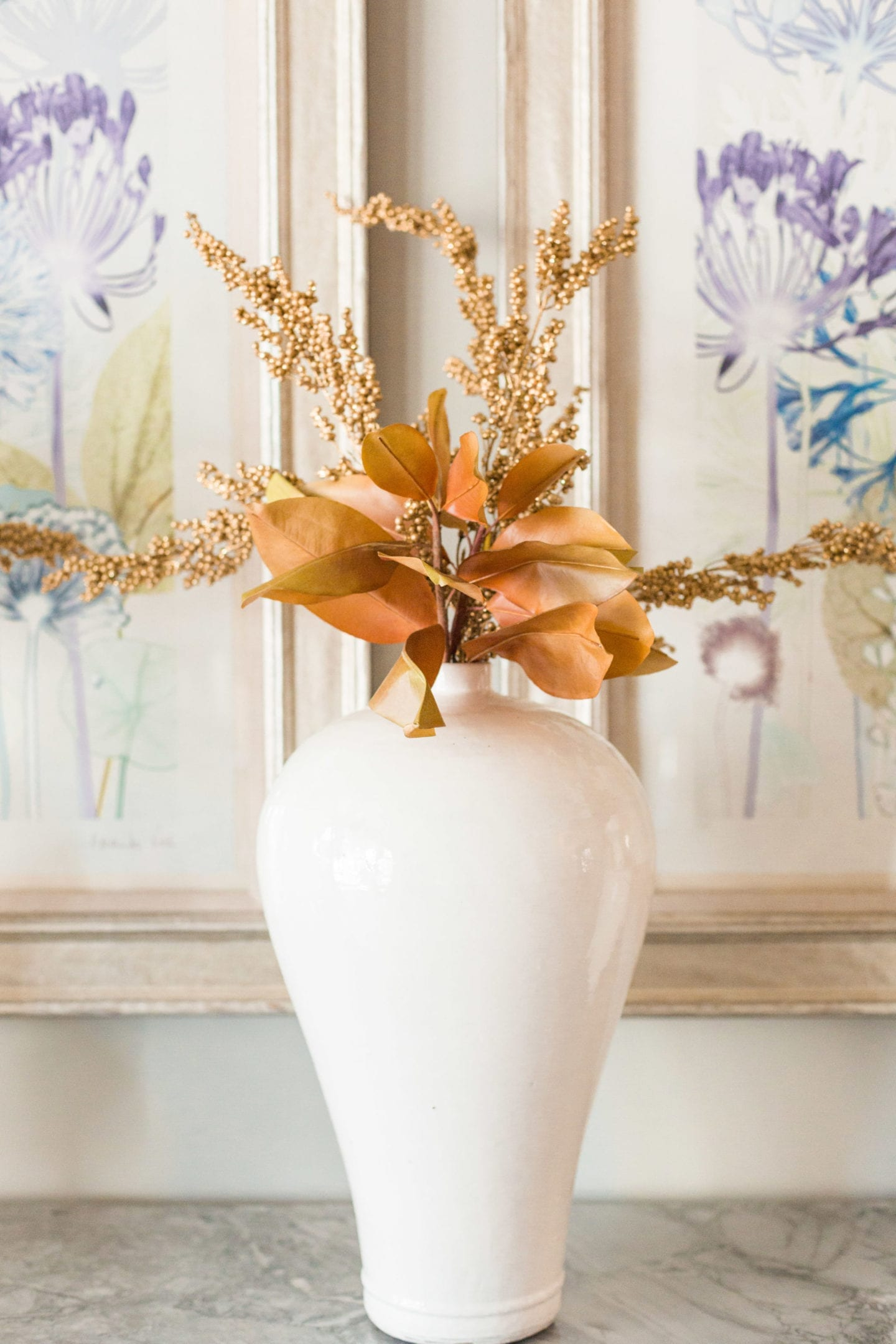 Fall Flowers in white vase. Artificial fall flowers and fall leaves for Thanksgiving centerpiece.
