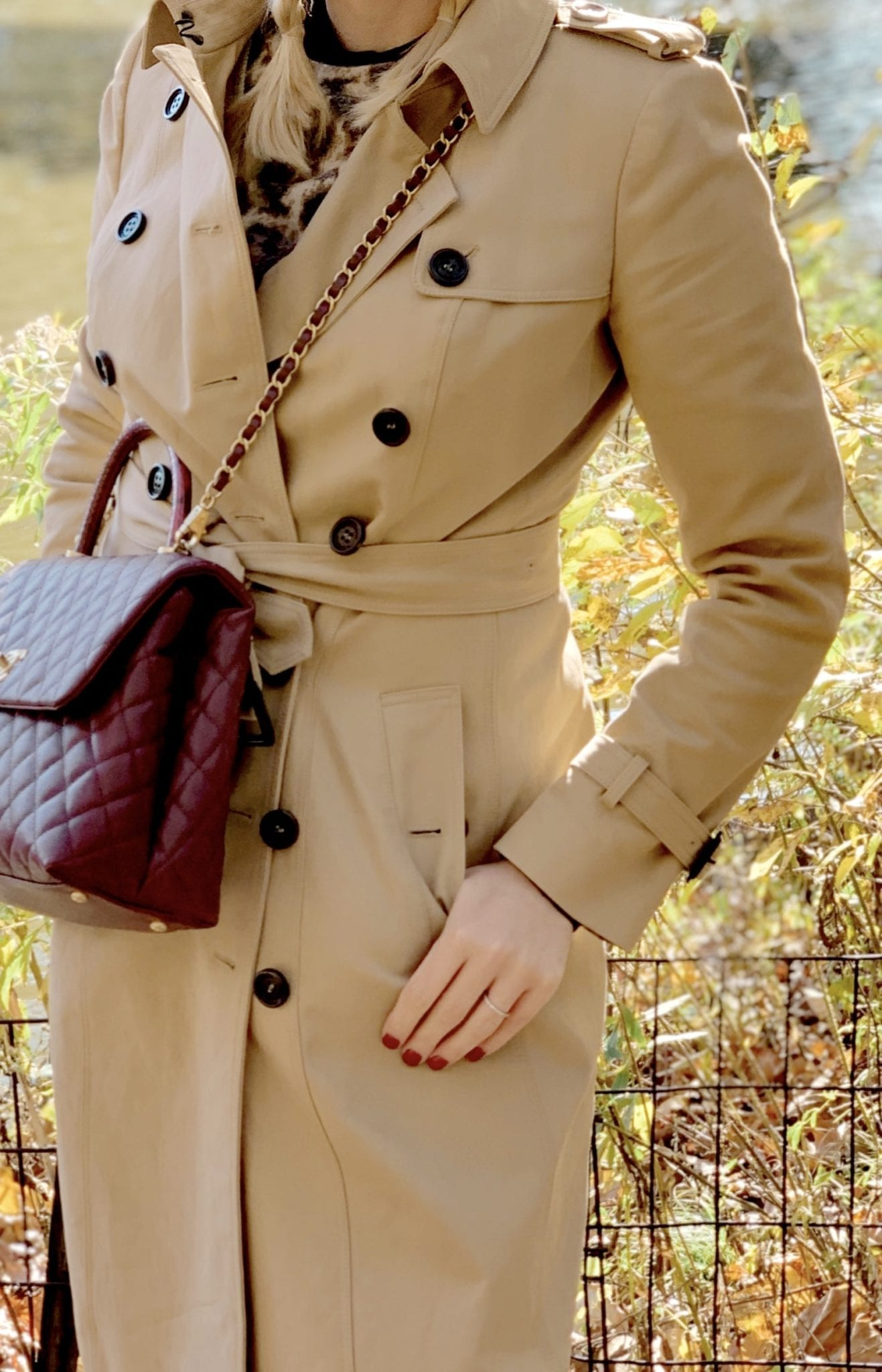 A Classic Trench coat from Burberry and Fall 2019 Chanel handbag in burgundy.