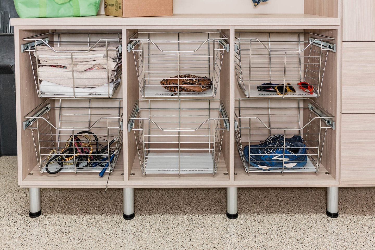 Garage and Attic Organization - baskets to store gym equipment and junk in your garage. Creative ways to keep things organized!
