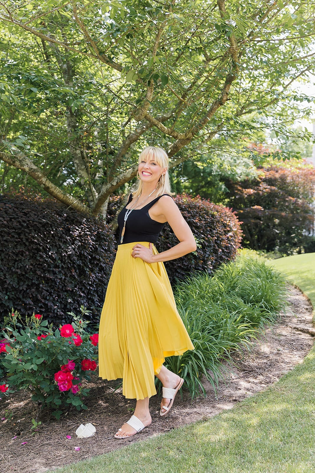 Yellow skirt outfit for summer with black bodysuit.
