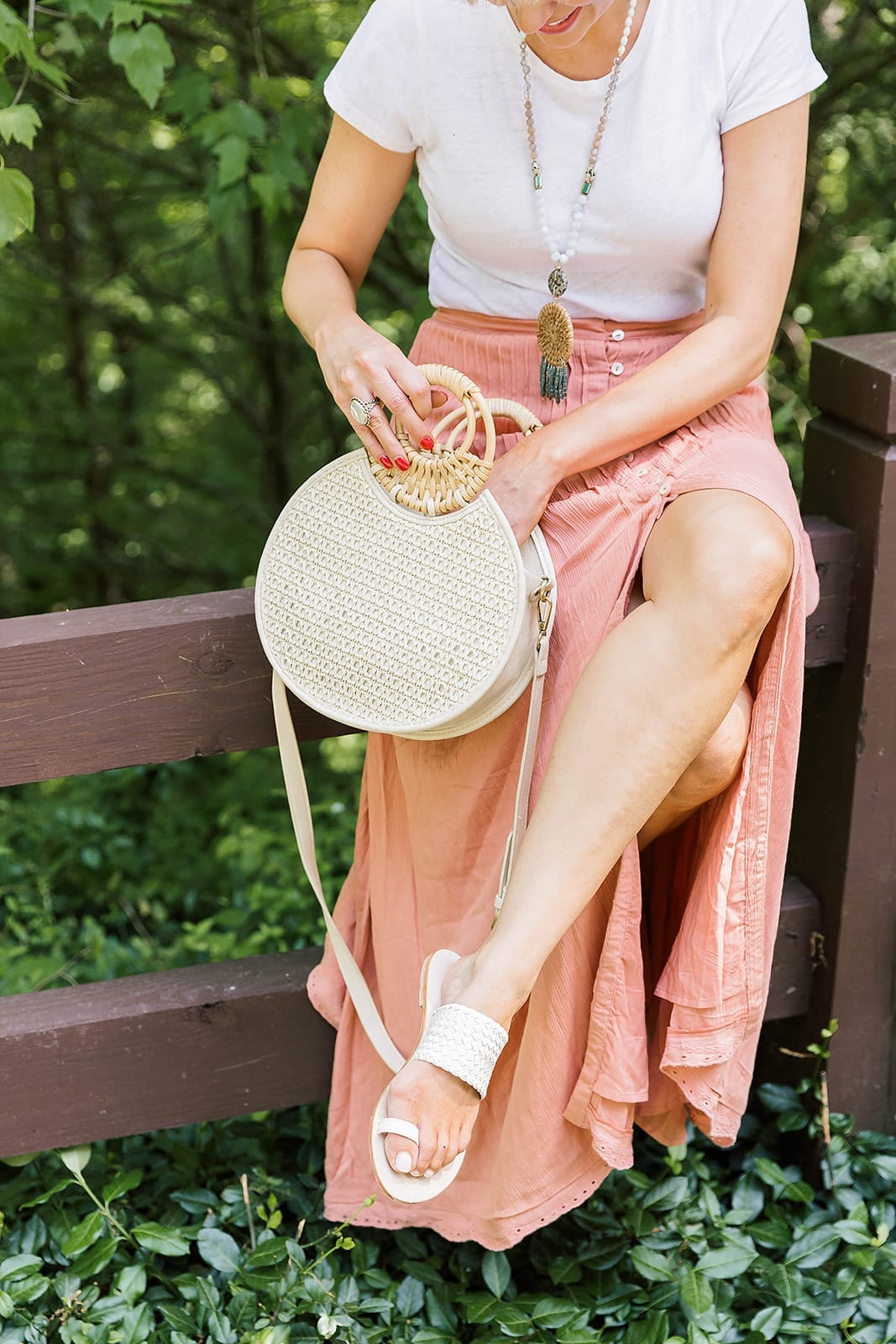 Pretty travel outfit with easy to wear maxi skirt, summer sandals and white t-shirt bodysuit.