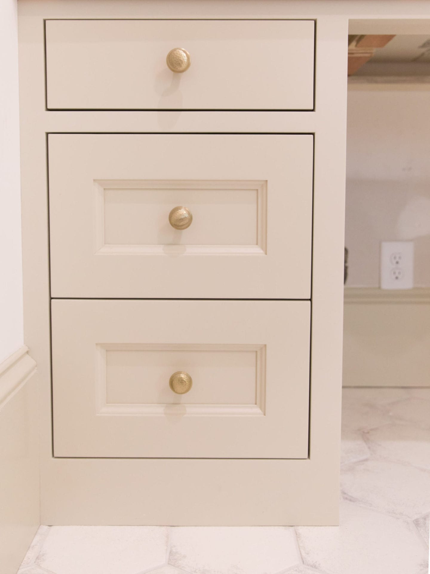 Hammered Hardware in bronze gold with Sherwin Williams Accessible Beige painted cabinets.