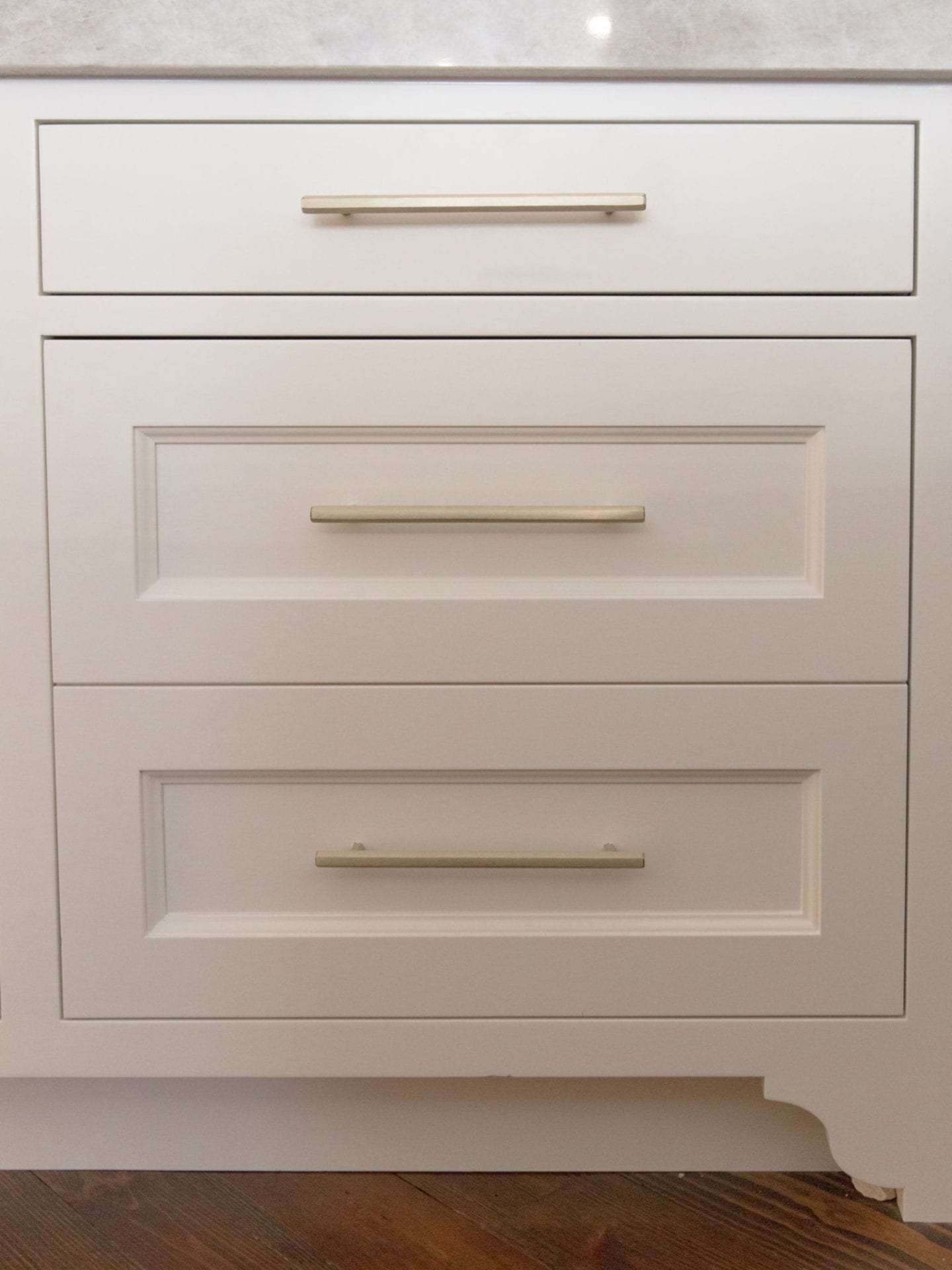 Luxury Hardware made by VESTA hardware. White Dove paint color for cabinetry with quartzite countertop in Taj Majal.