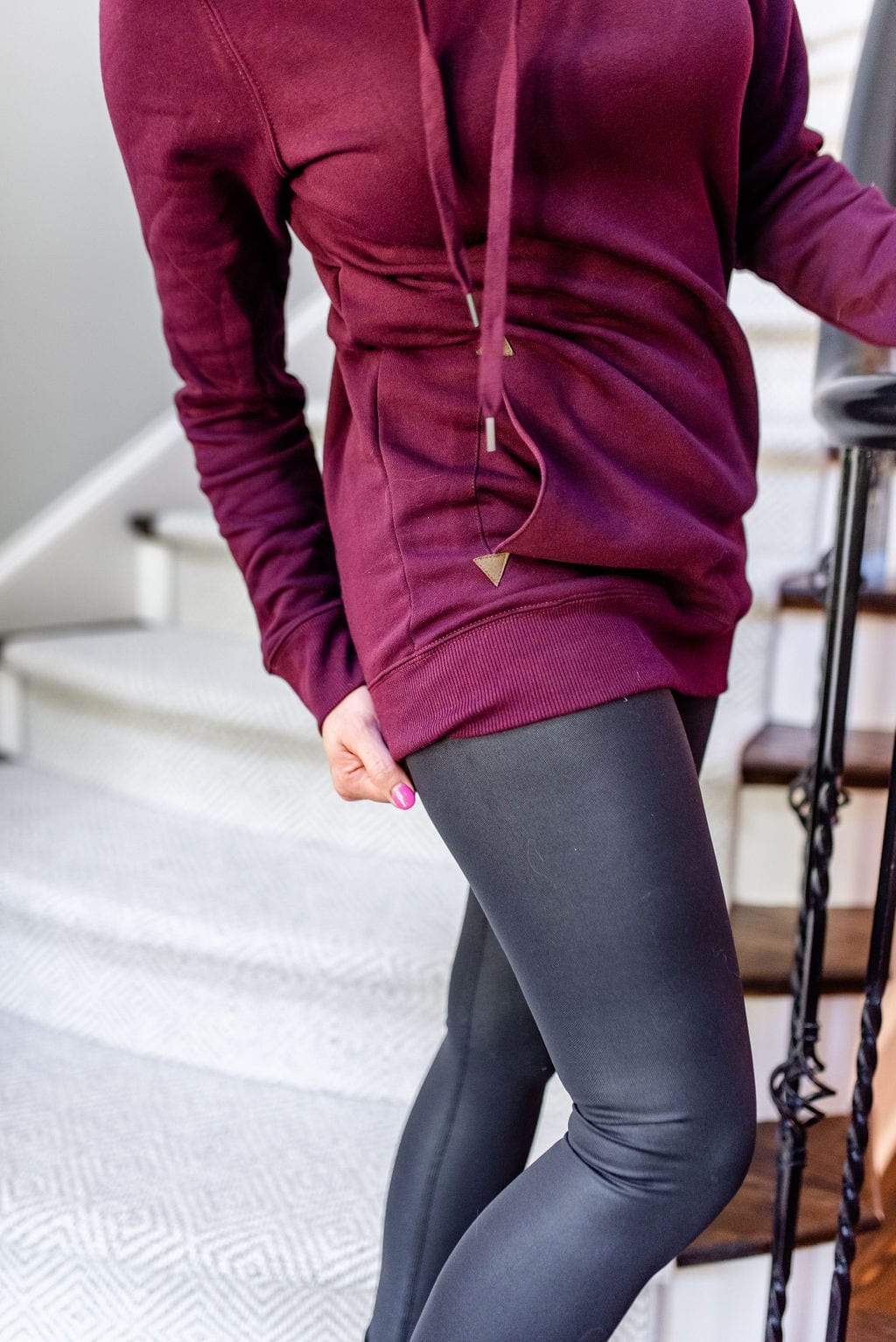 Long sweatshirt hoodie in dark maroon color with shiny yoga pants.