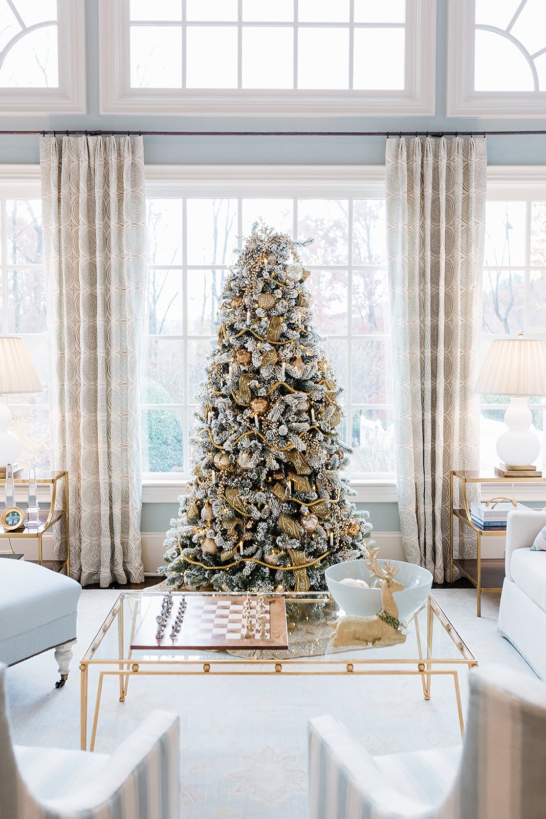 Visual description of what is a flocked Christmas tree. Gold Flocked Christmas Tree decorated by home blogger Kelly Page, for BlueGrayGal. Soft blue and gray living room with gold Christmas tree. This tree is covered with beautiful flock Christmas tree decorations