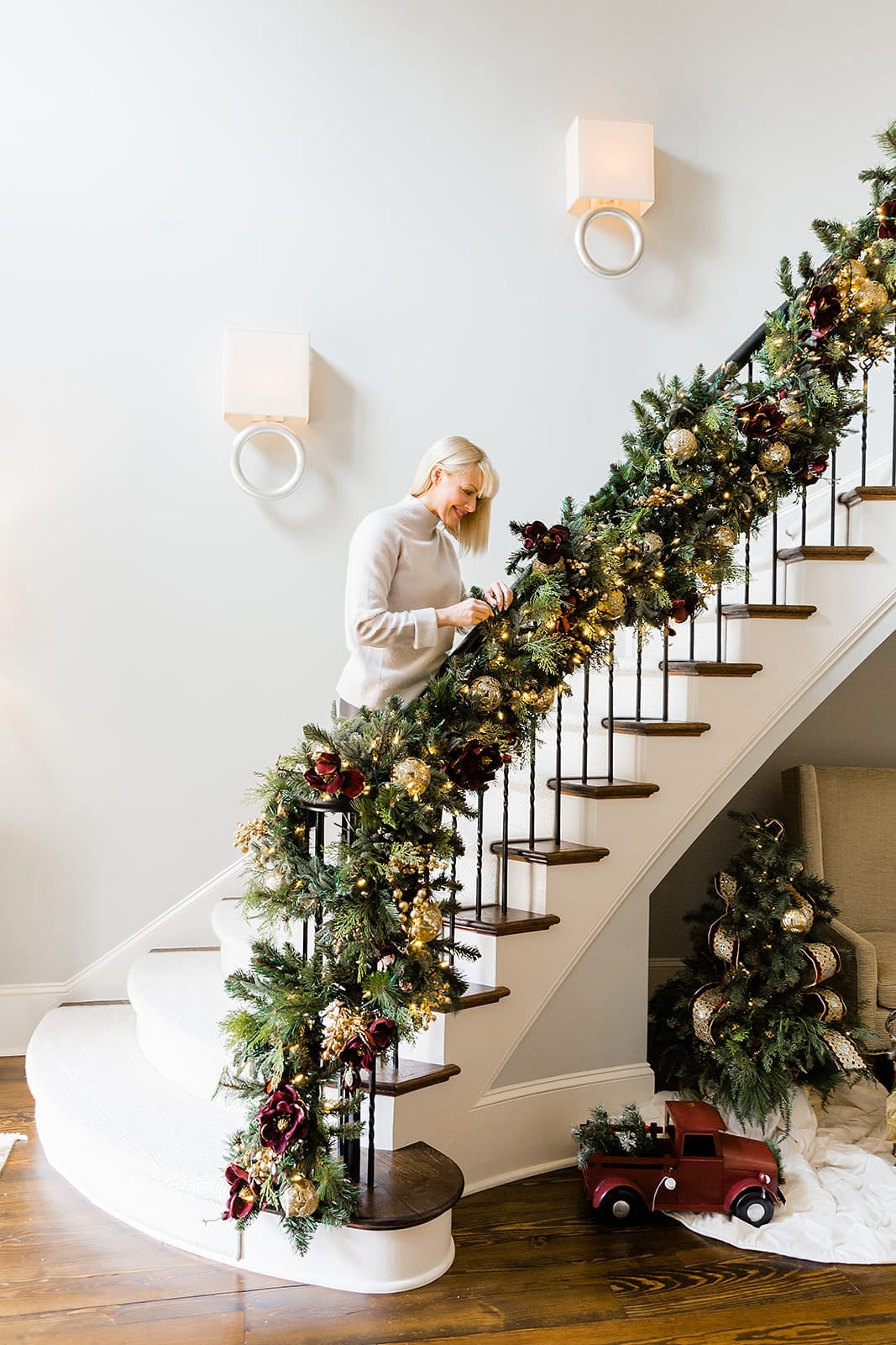 Banister Garland with Christmas Garland with Holiday Blogger BlueGrayGal. Sconces and Benjamin Moore Brushed Aluminum wall color.