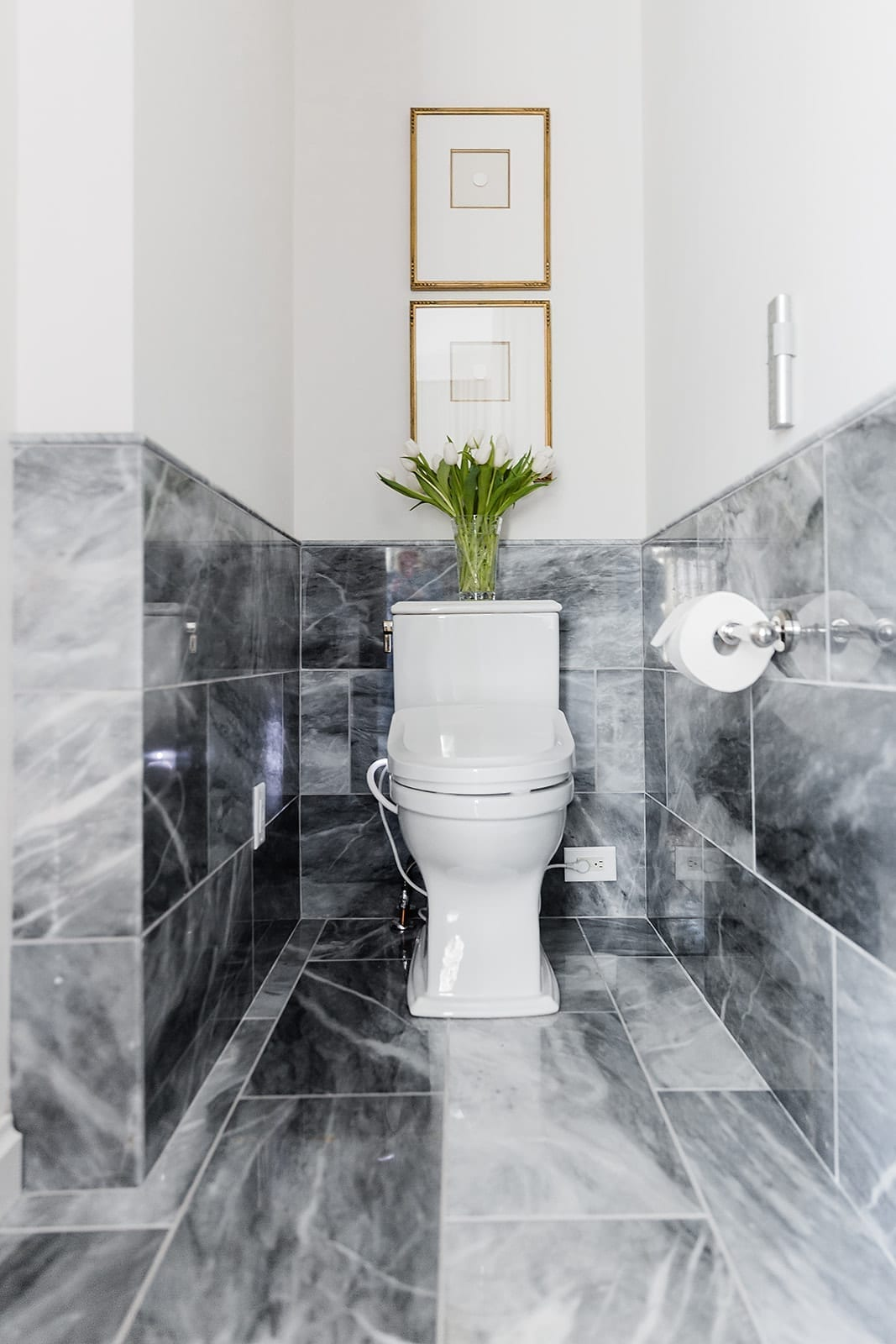 TOTO Toilet in master bathroom. Bardiglio marble floor and splash with Intaglio frames.