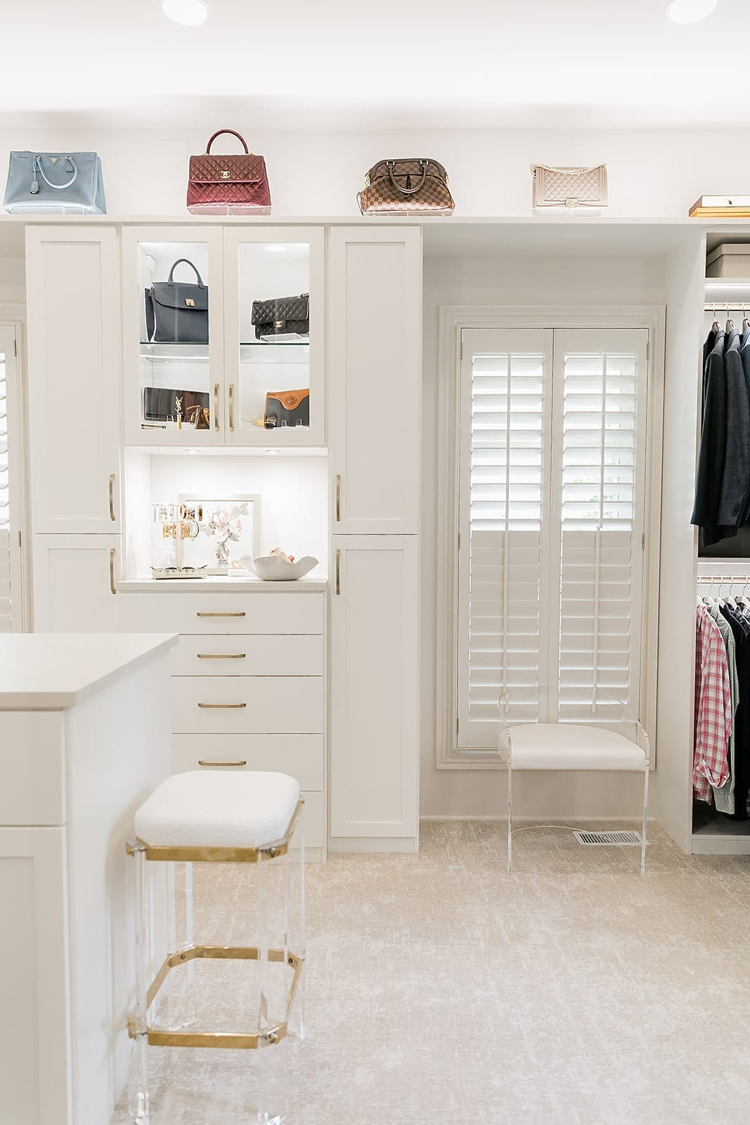 How to make your closet pretty. Display handbags in your closet with specialty closet lighting.