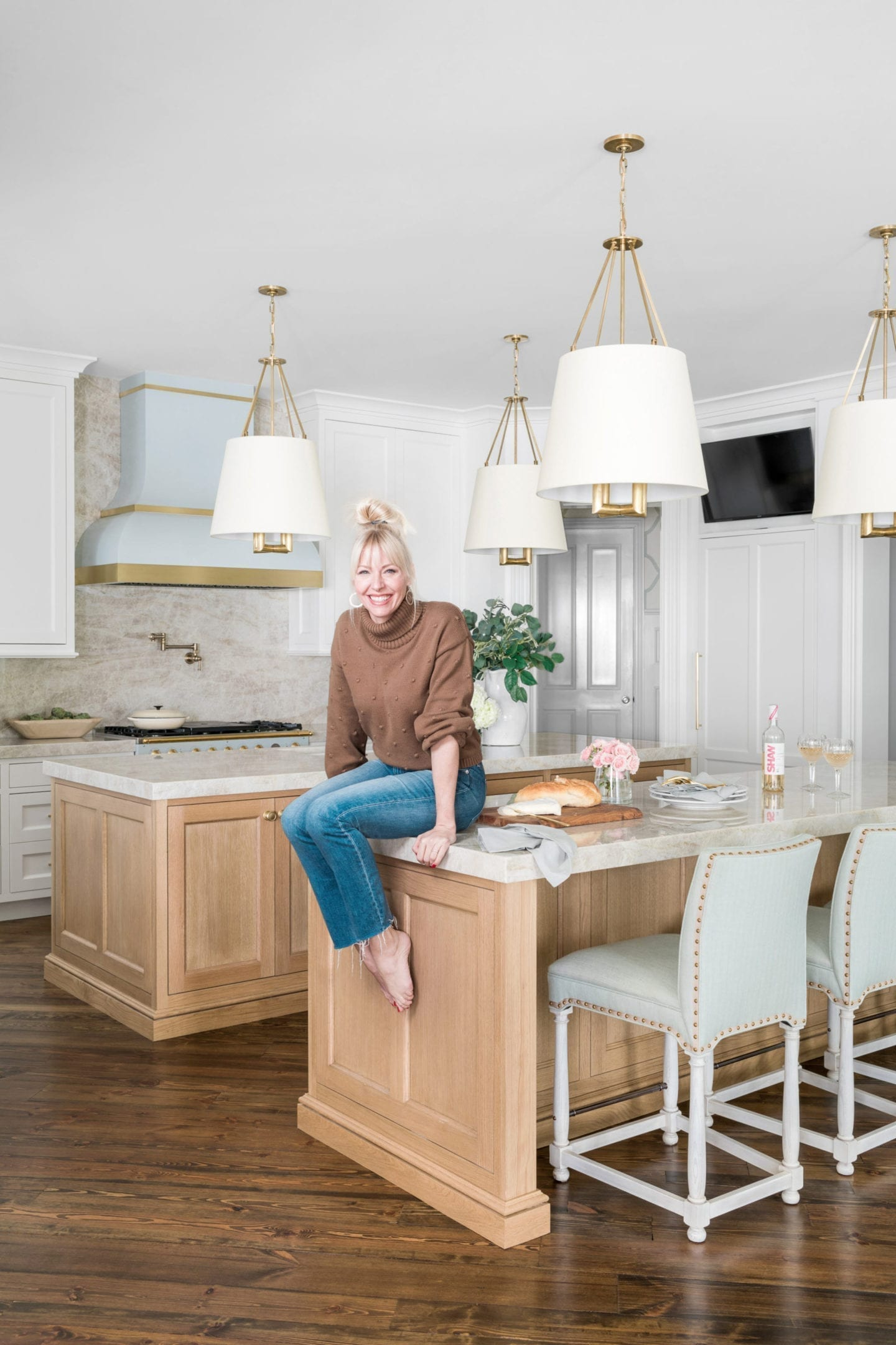Atlanta home blogger BlueGrayGal, Kelly Page, in her newly remodeled kitchen with blue, wood and taupe decor.