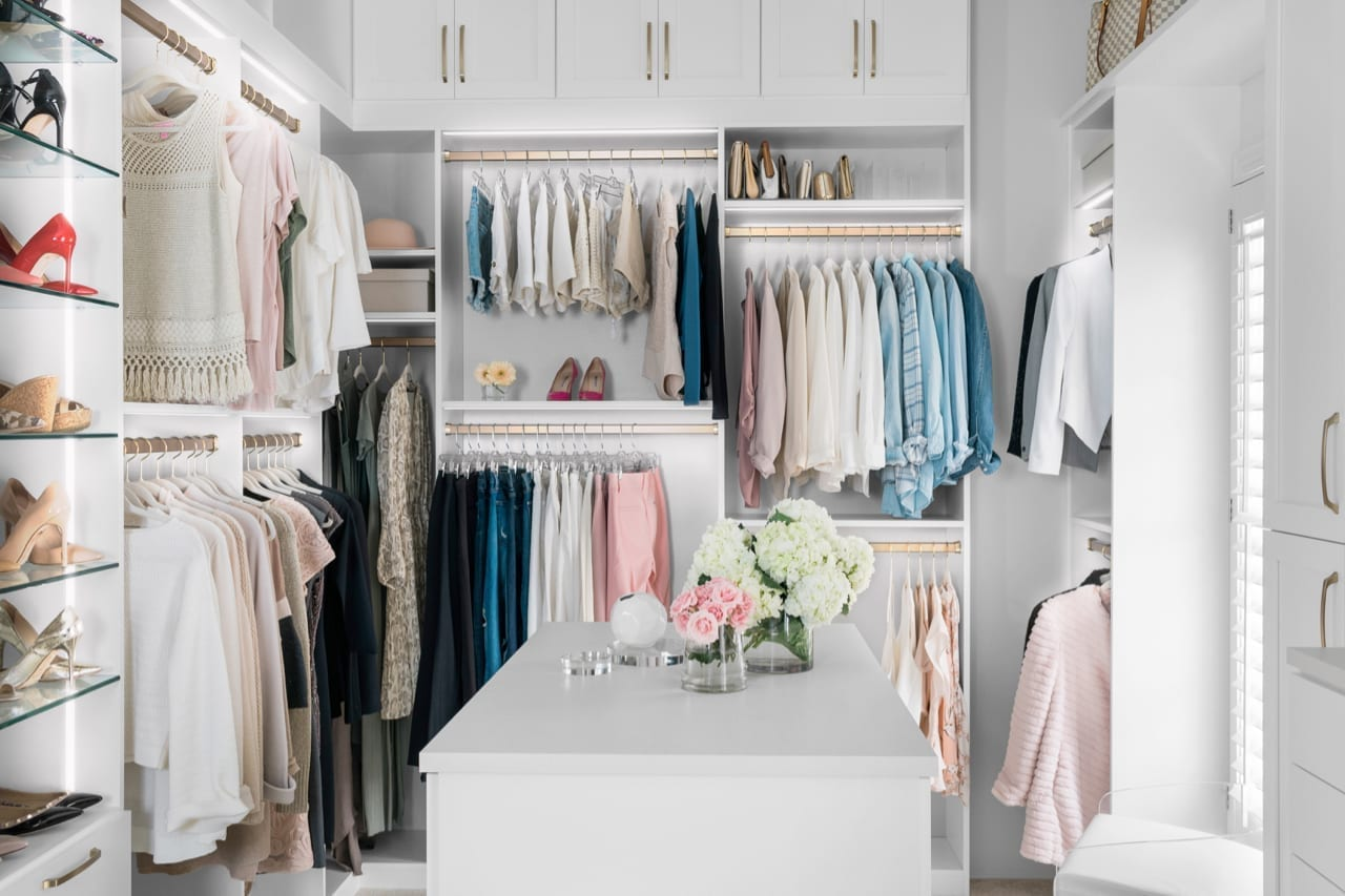 Luxury closet design by California Closets. Gold hardware, white and linen backing in home blogger Kelly Page blueGrayGals Atlanta home.
