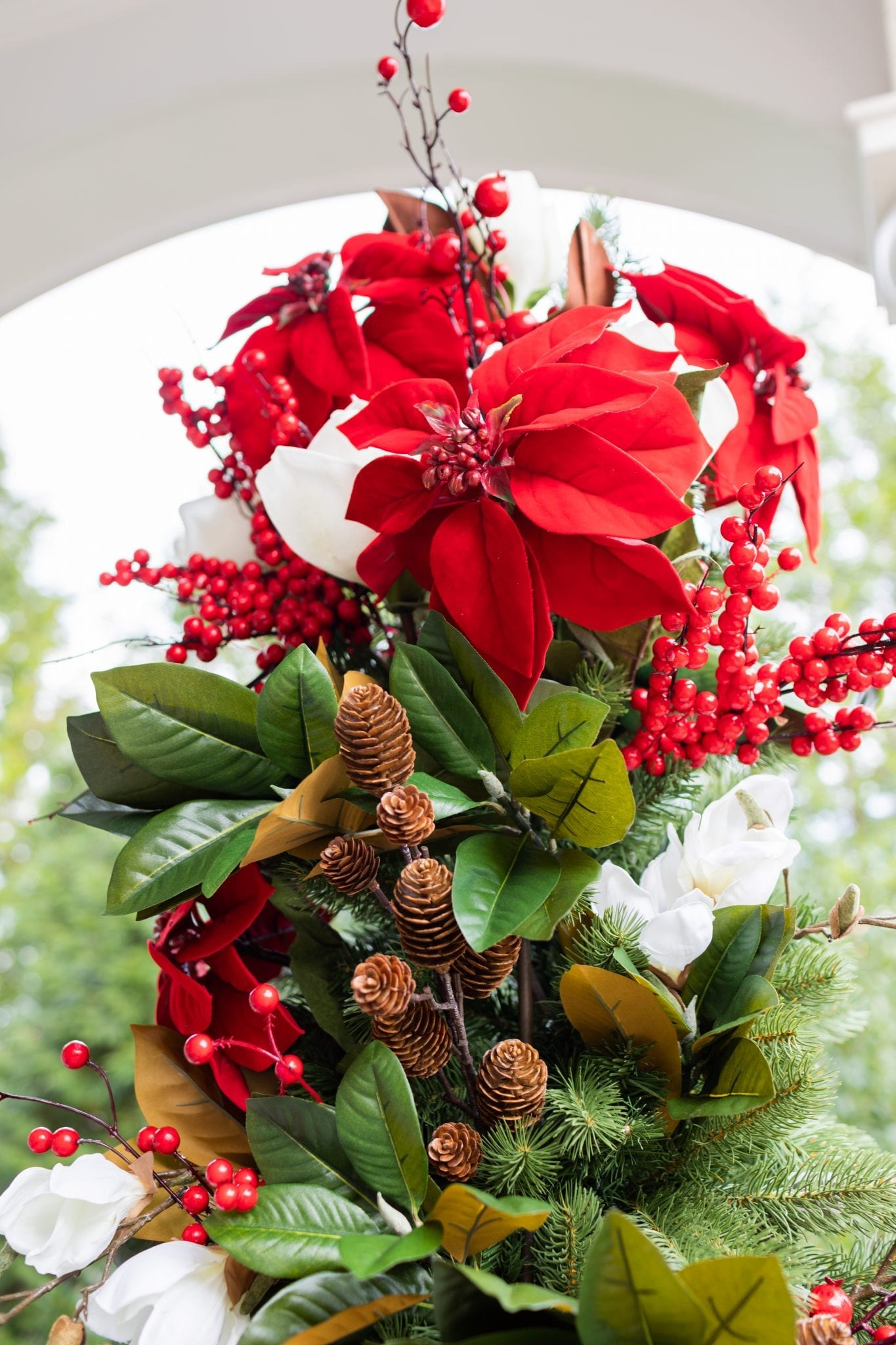 To create a simply southern Christmas, you need basic ingredients: magnolia, poinsettia & a bit of the outdoors! This magnolia tree is beautiful both inside or for balcony christmas decorations! If you need Christmas balcony ideas, this tree along with artificial poinsettia plants for outside may be just the ticket!