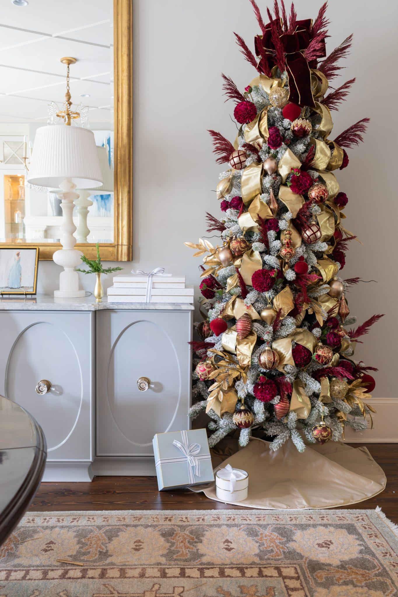 Decorating a white flocked Christmas tree and need some ideas? Flocked artificial Christmas trees give you so much room for new color ways & schemes! These flock Christmas tree ideas will inspire you to get a flocked tree this year and make your own mark on the holiday!