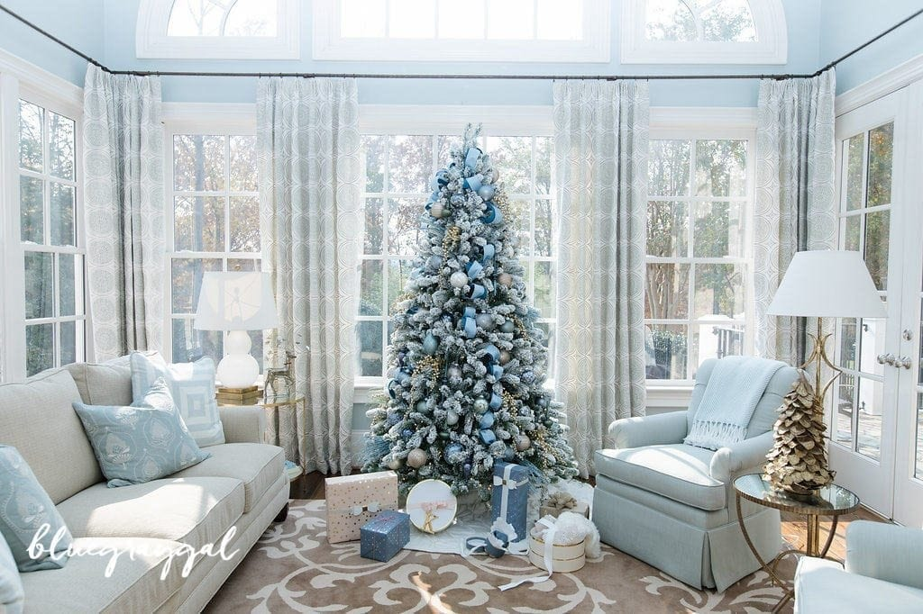 Blue Christmas tree decorations with blue Christmas ornaments and light blue ribbon and blue Christmas presents.